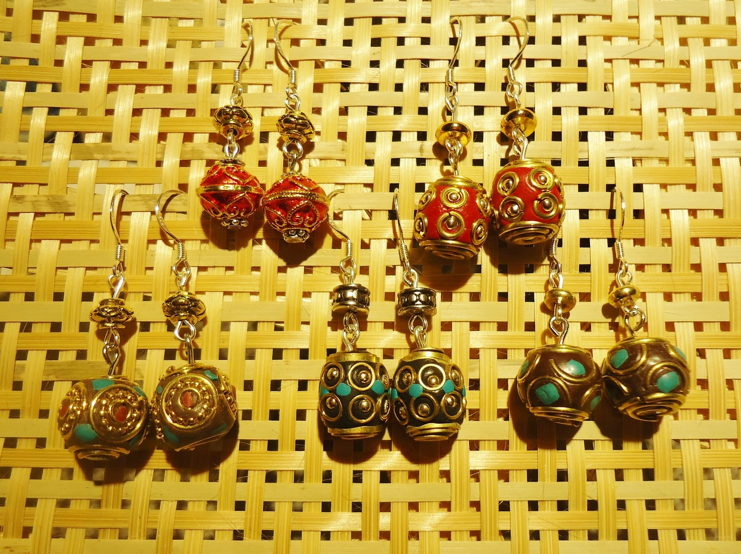 Earrings (a) by Mary of Dongxiang