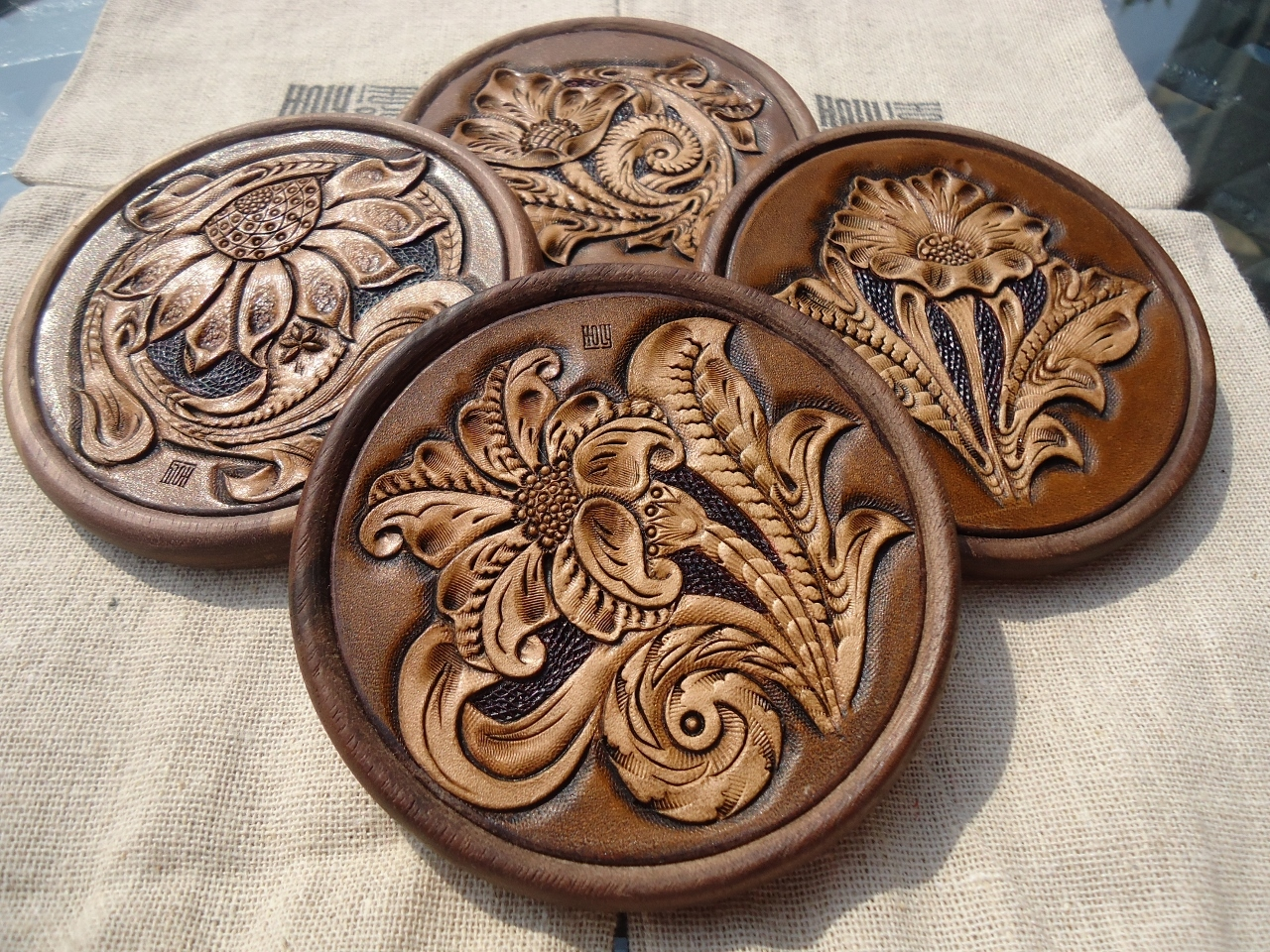 <p>Yu Family 'Holy' Leather and Wood Coaster</p>