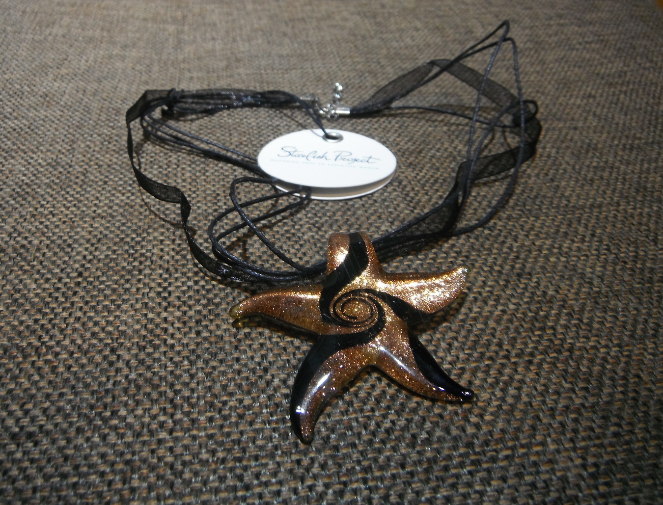 <p>Starfish Glass Swirl Starfish Necklace&nbsp;</p>